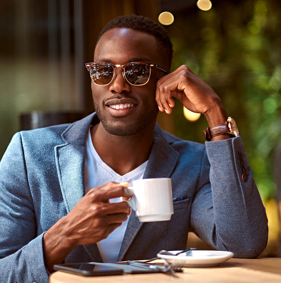 man in glasses drinking coffee